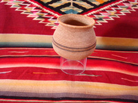 Native American Indian basket, a very finely woven polychrome olla, Chemehuevi, c. 1920's. Main photo of the Chemehuevi Indian basket.