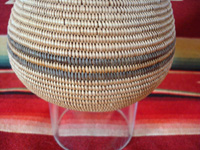 Native American Indian basket, a very finely woven polychrome olla, Chemehuevi, c. 1920's. Closeup photo of the polychrome band around the middle of the Chemehuevi Indian basket.