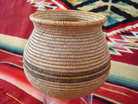 Native American Indian basket, a very finely woven polychrome olla, Chemehuevi, c. 1920's. Another photo of the Chemehuevi Indian basket.