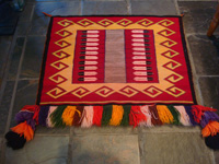 Native American Indian textiles and Navajo rugs, a Navajo fancy saddleblanket, pictorial and with wonderful fringe decorations, c. 1940's. Main photo.
