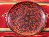 Mexican vintage wood-carving and Mexican vintage folk art, a wooden oval charger from Olinala, Guerrero, laquered and with beautifully incised decorations, c. 1930's. Main photo of Olinala laquer-ware charger.