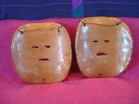 Mexican vintage pottery, and Mexican vintage folk-art, a pair of wonderful pottery masks from Amayaltepec, Guerrero, c. 1950's. Photo of the back side of the two masks.