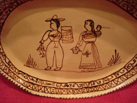 Mexican vintage pottery and ceramics, a lovely oval charger with a wonderful scene of a family near Lake Patzcuaro, in the traditional style of the village of Tzintzuntzan, Michoacan, c. 1950's.  Closeup of the scene on the front of the platter.