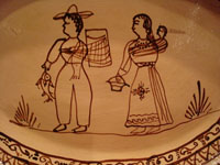 Mexican vintage pottery and ceramics, a lovely oval charger with a wonderful scene of a family near Lake Patzcuaro, in the traditional style of the village of Tzintzuntzan, Michoacan, c. 1950's.  Another closeup of the scene on the front of the platter.