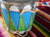 Native American Indian vintage folk art, a wonderful Pueblo dance drum, decorated with vivid designs and colors, Pueblos of New Mexico, c. 1950's. Closeup photo of the side of the drum.