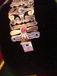 "Mexican vintage sterling silver jewelry, and Taxco vintage silver jewelry, a very beautiful sterling silver bracelet with caboshons and magenta-colored stones (four of each), signed ""Mexico"", c. 1940's.  Closeup photo of the clasp of the Taxco silver bracelet."