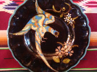 Mexican vintage pottery and ceramics, a lovely black-ware plate with a beautiful bird (a quetzal?) and fantastic flowers, Tlaquepaque or Tonala, Jalisco, c. 1920-30's. Closeup photo of the lovely bird and flowers on the front of the Tlaquepaque plate.
