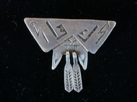 Native American Indian vintage silver jewelry, and Navajo silver jewelry, a beautiful silver broach depicting the Navajo rain clouds and thunder, c. 1940's. Closeup photo of the Navajo silver broach.