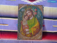 Mexican vintage devotional art, and Mexican vintage tinwork art, a lovely tinwork-art retablo depicting St. Joseph with the child Jesus, c. 1920. Main photo of the retablo.