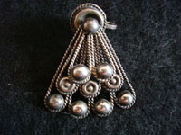Closeup photo of Mexican vintage silve jewelry, Taxco sterling silver earrings with fan-shape.