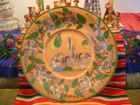 Mexican vintage pottery and ceramics, an incredibly large and beautiful pottery charger from Tlaquepaque, Jalisco, c. 1920-30's. The artwork on this charger is spectacular. This piece is museum-quality! Main photo of charger.