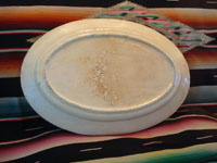 Mexican vintage pottery and ceramics, a beautiful oval platter decorated with a very lovely bird and flowers, Talquepaque, Jalisco, c. 1930-40's. Photo of the back of the platter.