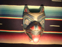 Native American Indian wood-carving and folk art, a Northwest Coast carved wooden miniature mask in the form of a bear with abalone inlaid eyes, signed LAVALLE, c. 1960's. Main photo of the Northwest Coast carved wooden mask.
