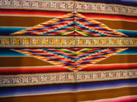 Mexican vintage textiles and sarapes, a spectacular Saltillo sarape with bands of tela deshilada (threads are removed and lovely flowers are then created with the remaining threads), c. 1920-40. This is an extremely rare and beautiful Mexican textile.  Photo of the center medallion of the sarape.