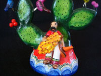 Mexican vintage pottery and ceramics, and Mexican vintage folk-art, a wonderful pair of trees-of-like, signed by the late, famous folk-artist, Alfonso Castillo, of Izucar de Matamoros, Puebla, c. 1990's. Closeup photo of the Mexican caballero near the base of one tree.