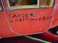 Mexican vintage folk-art, and Mexican vintage pottery and ceramics, a beautiful pottery city bus filled with happy passengers, signed on the side of the bus by the famous, late folk-artist, Candelario Medrano of Santa Cruz de las Huertas, Jalisco, c. 1960's. Photo of the side of the car or bus with the signature of Medrano, the artist.