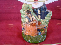 Mexican vintage pottery and ceramics, and Mexican vintage folk art, a wonderful pottery sculpture or statue depicting a lovely woman at a well, with the village church in the background, Tlaquepaque or Tonala Jalisco, c. 1930's. Main photo of the Tlaquepaque pottery figure.