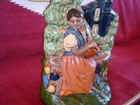 Mexican vintage pottery and ceramics, and Mexican vintage folk art, a wonderful pottery sculpture or statue depicting a lovely woman at a well, with the village church in the background, Tlaquepaque or Tonala Jalisco, c. 1930's. Another angle of the woman at a well, gracing the Tlaquepaque pottery figure.