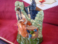 Mexican vintage pottery and ceramics, and Mexican vintage folk art, a wonderful pottery sculpture or statue depicting a lovely woman at a well, with the village church in the background, Tlaquepaque or Tonala Jalisco, c. 1930's. A third angle of the pottery figure.