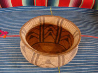 Native American Indian baskets, a very wonderful and rare Chemehuevi basket with an unusual oblong shape and a beautiful geometric pattern of decoration, from near Parker, Arizona, along the Colorado river, c. 1900.  Photo shot from above the Chemehuevi basket, looking down.