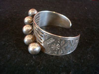 Native American Indian vintage sterling silver jewelry, and Navajo vintage silver jewelry, a beautiful sterling silver bracelet with five silver spheres and very fine stamping, Navajo, c. 1940's. Main photo of the Navajo silver jewelry bracelet.