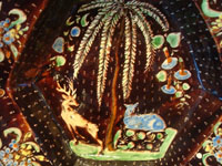 Mexican vintage pottery and ceramics, a stunning pottery bowl with a beautiful black background and a starry night pattern, and highly intricate artwork decorations, Tonala or San Pedro Tlaquepaque, c. 1920-30's. Closeup photo of the animals and trees decorating the front of the bowl.