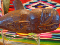 Native American Indian woodcarving and folk art, a beautiful wood-carved figure of a whale, Northwest Coast, perhaps Kwaiutl, c. 1940's, cedar, unsigned.  Side view of the swimming whale.