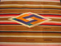 Mexican vintage textiles, and Mexican vintage Saltillo sarapes (serapes), a lovely Saltillo sarape runner with beautiful colors and a wonderful center medallion, c. 1940's. Closeup photo of the lovely center medallion of the Saltillo sarape.