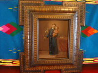 Mexican colonial art, and Mexican tinwork art and retablos, a stunning retablo depicting Saint Anthony and the Child Jesus, painted on copper and in a handmade wooden frame, Mexico, c. 18th-early 19th century. Main photo of the retablo on copper.