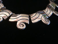 Mexican vintage sterling silver jewelry, and Taxco vintage sterling silver jewelry, a beautiful silver necklace and earrings set, Taxco, c. 1940's. Closeup photo of a part of the Taxco silver necklace.