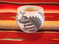 Native American Indian vintage pottery, a fine Acoma pot with an insect (bee or moth) motif, signed M. Antonio, c. 1960's. The insect motif is repeated three times, separated each time by the cloud/rain motif. Main photo of the Acoma pot by M. Antonio.
