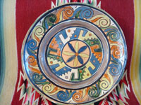 Mexican vintage pottery and ceramics, a wonderful petatillo (background with straw-like hatching) plate from Tlaquepaque, c. 1930-40. The plate has a very unique and early geometric and floral design. Main photo of the plate.