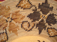 Native American Indian basket, a fantastic basketry hat by the famed contemporary basket-weaver, Abe Sanchez, from California, c. 1990. Closeup photo.