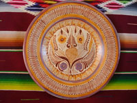 Mexican vintage pottery and ceramics, a beautiful Tonala canelo charger by the famous artist N. Pajarito, Tonala, c. 1970's.  Main photo of the front of the charger.