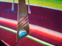 Native American Indian vintage silver jewelry, and Navajo silver jewelry, a lovely pair of dangling Navajo silver earrings with beautiful turquoise, c. 1950's. A closeup photo of the bottom of one Navajo silver earring, showing the lovely turquiose.
