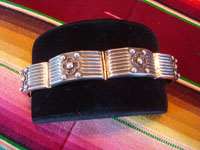 Mexican vintage sterling silver jewelry, and Taxco vintage silver jewelry, a lovely silver bracelet with excellent repousse work (or bump out's), Taxco, c. 1940's. Main photo of the Taxco silver bracelet.