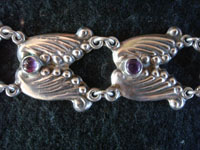 Mexican vintage sterling silver jewelry, and Taxco vintage silver jewelry, a stunning silver bracelet with beautiful amethyst cabochons, Taxco, c. 1930's. Closeup photo of the Taxco silver jewelry bracelet with amethyst cabochons.