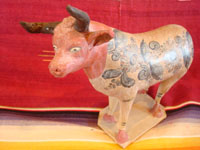 Mexican vintage pottery and ceramics, and vintage Mexican folk art, a wonderful burnished pottery bank in the form of a wonderful bull, with very detailed artwork on both sides, Tonala or Tlaquepaque, c. 1930's. A closeup view of the burnished pottery bull from Tonala or Tlaquepaque.