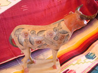 Mexican vintage pottery and ceramics, and vintage Mexican folk art, a wonderful burnished pottery bank in the form of a wonderful bull, with very detailed artwork on both sides, Tonala or Tlaquepaque, c. 1930's. A photo showing the decorations on the second side of the burnished pottery bull from Tonala or Tlaquepaque, Jalisco.