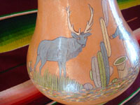 Mexican vintage pottery and ceramics, a beautiful pottery vase with very fine artwork decoration, Tlaquepaque or Tonala, Jalisco, c. 1930's. Closeup photo of an animal on one side of the Arias pottery vase from Tlaquepaque.