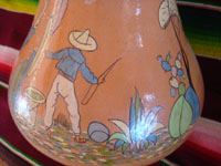 Mexican vintage pottery and ceramics, a beautiful pottery vase with very fine artwork decoration, Tlaquepaque or Tonala, Jalisco, c. 1930's. Closeup photo of a Mexican man on one side of the Arias pottery vase from Tlaquepaque.