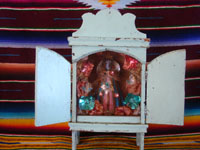 Mexican vintage devotional art, a beautiful statue of Our Lady of Juquila set inside of a homemade wooden nicho with doors, Oaxaca, c. 1940's. Main photo of the nicho.