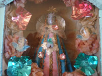 Mexican vintage devotional art, a beautiful statue of Our Lady of Juquila set inside of a homemade wooden nicho with doors, Oaxaca, c. 1940's. Closeup photo of Our Lady of Juquila inside of the wooden nicho.