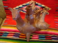 Mexican vintage folk art, and Mexican vintage pottery and ceramics, a beautiful burnished pottery candleabra, attributed to the great artist, Heron Martinez, with zoomorphic figures, Acatlan, Puebla, c. 1940's. Main image of the piece by Heron Martinez.