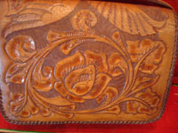 Mexican vintage folk art, and Mexican vintage leather-work, a beautiful leather purse with wonderful tooled floral designs, c. 1930's.  Another closeup photo of the tooling.