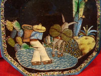 Mexican vintage pottery and ceramics, a blackware octogonal plate with very fine and detailed artwork and a lovely border, Tonala or Tlaquepaque, Jalisco, c. 1930.  Closeup photo of the artwork on the plate, featuring a campesino crossing a creek with his burro.