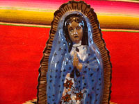 Mexican vintage devotional art, and Mexican vintage pottery and ceramics, a beautiful pottery figure of Our Lady of Guadalupe with wonderful form and colors, Tzintzuntzan, Michoacan, c. 1970.  Closeup photo of Our Lady's face.