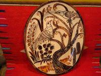 Mexican vintage pottery and ceramics, a petatillo oval platter with wonderul decorations featuring graceful birds and plants, Tonala or Tlaquepaque, Jalisco, c. 1940, attribute to the Lucano family, and, very possibly, by the famous Balbino Lucano. Main photo of the platter.