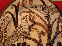 Mexican vintage pottery and ceramics, a petatillo oval platter with wonderul decorations featuring graceful birds and plants, Tonala or Tlaquepaque, Jalisco, c. 1940, attribute to the Lucano family, and, very possibly, by the famous Balbino Lucano. Closeup photo of some of the birds and plants on the front of the platter.