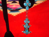 Native American Indian vintage silver jewelry, and Zuni vintage silver jewelry, a lovely pair of dangling Zuni earrings of sterling silver and lovely inlaid turquoise, Zuni, New Mexico, c. 1940's. Closeup photo of one of the Zuni silver earrings.